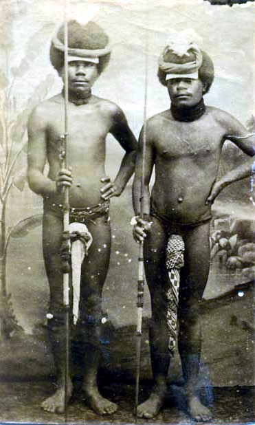 two_kanak_canaque_warriors_posing_with_penis_gourds_and_spears_new_caledonia.jpg