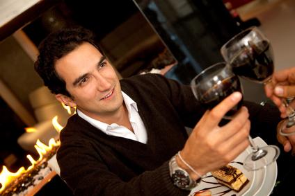 stockfresh_1395263_man-toasting-with-wine_sizexs.jpg