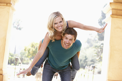 stockfresh_96976_young-man-giving-woman-piggyback-outdoors_sizexs.jpg