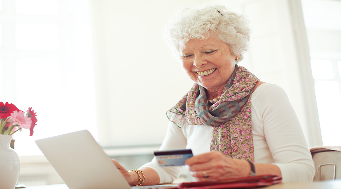 old-woman-happy-doing-her-shopping-online-using-a-credit-card_s6mmdbrnfe_jpg2.jpg