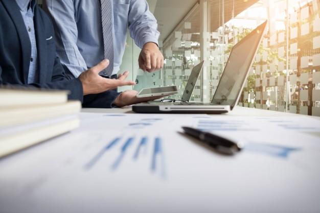 business-adviser-analyzing-financial-figures-denoting-progress-work-company_1423-97.jpg