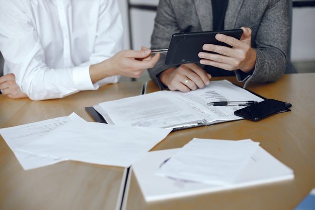 business-men-sitting-lawyers-s-desk-people-signing-important-documents_1157-40457.jpg