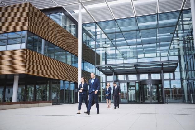 business-people-walking-outside-office-building_107420-74359.jpg