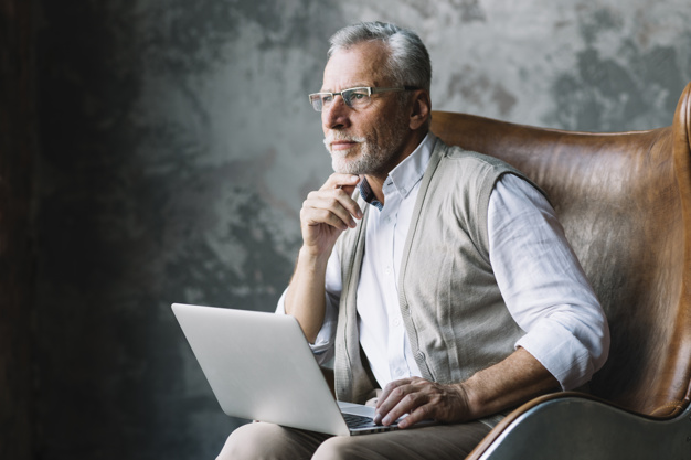 contemplated-elderly-man-sitting-chair-with-laptop-against-grunge-background_23-2147901042.jpg