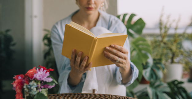 flower-vase-front-young-woman-reading-yellow-book_23-2148066862.jpg