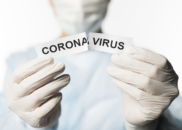 front-view-doctor-holding-torn-paper-with-coronavirus_23-2148450254.jpg