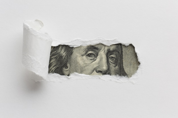 ripped-paper-revealing-dollar-bill_23-2148285353.jpg