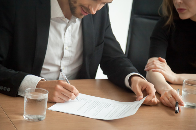 satisfied-smiling-businessman-suit-signing-contract-meeting-concept_1163-4653.jpg