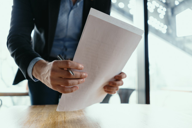 successful-business-man-signing-documents-modern-office_158595-5384.jpg