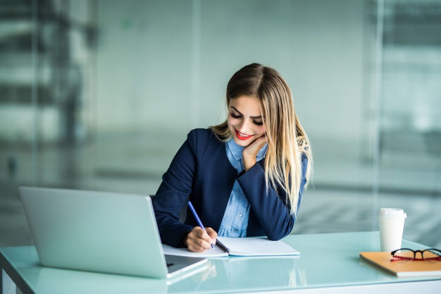 young-pretty-woman-working-with-laptop-taking-notes-desktop-office_231208-5894.jpg