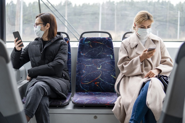 young-women-using-public-transport-with-surgical-mask_23-2148454309.jpg
