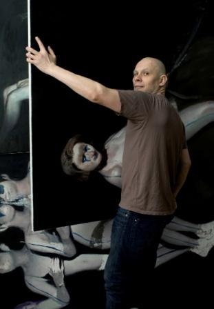 Alexander Tinei and his painting.jpg