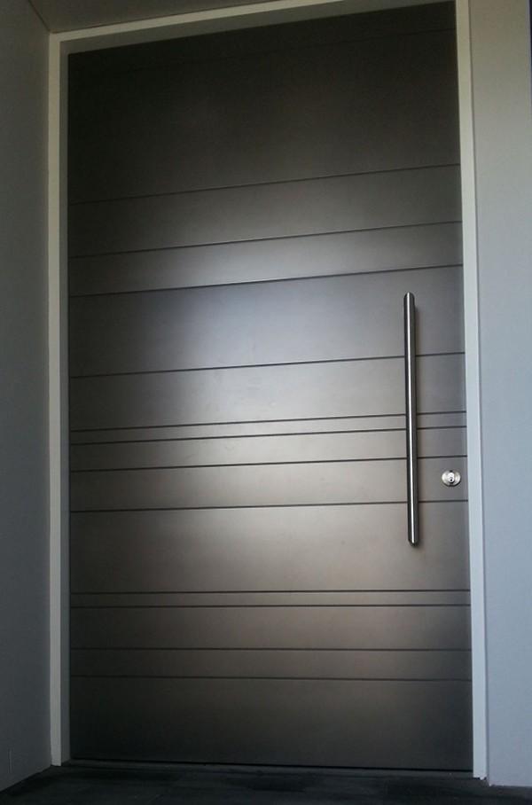 minimalist-black-front-door-600x908.jpg
