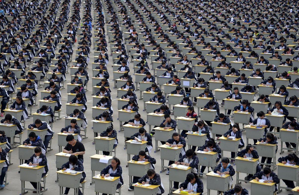 students-take-an-exam-at-a-high-schools-open-air-playground-in-yichuan-shaanxi-province-more-than-1700-freshmen-students-took-part-in-the-exam-in-2015-which-the-school-moved-outside-because-of-insufficient.jpg