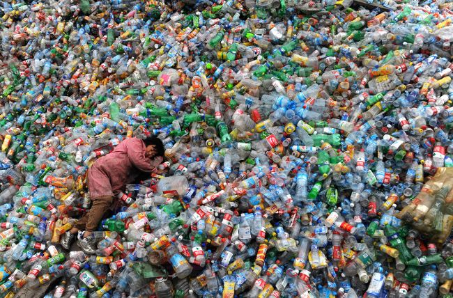 a-laborer-rests-on-piles-of-plastic-bottles-at-a-recycling-center-in-jiaxing-zhejiang-province-china-on-november-6-2011_-reutersstringer.jpg