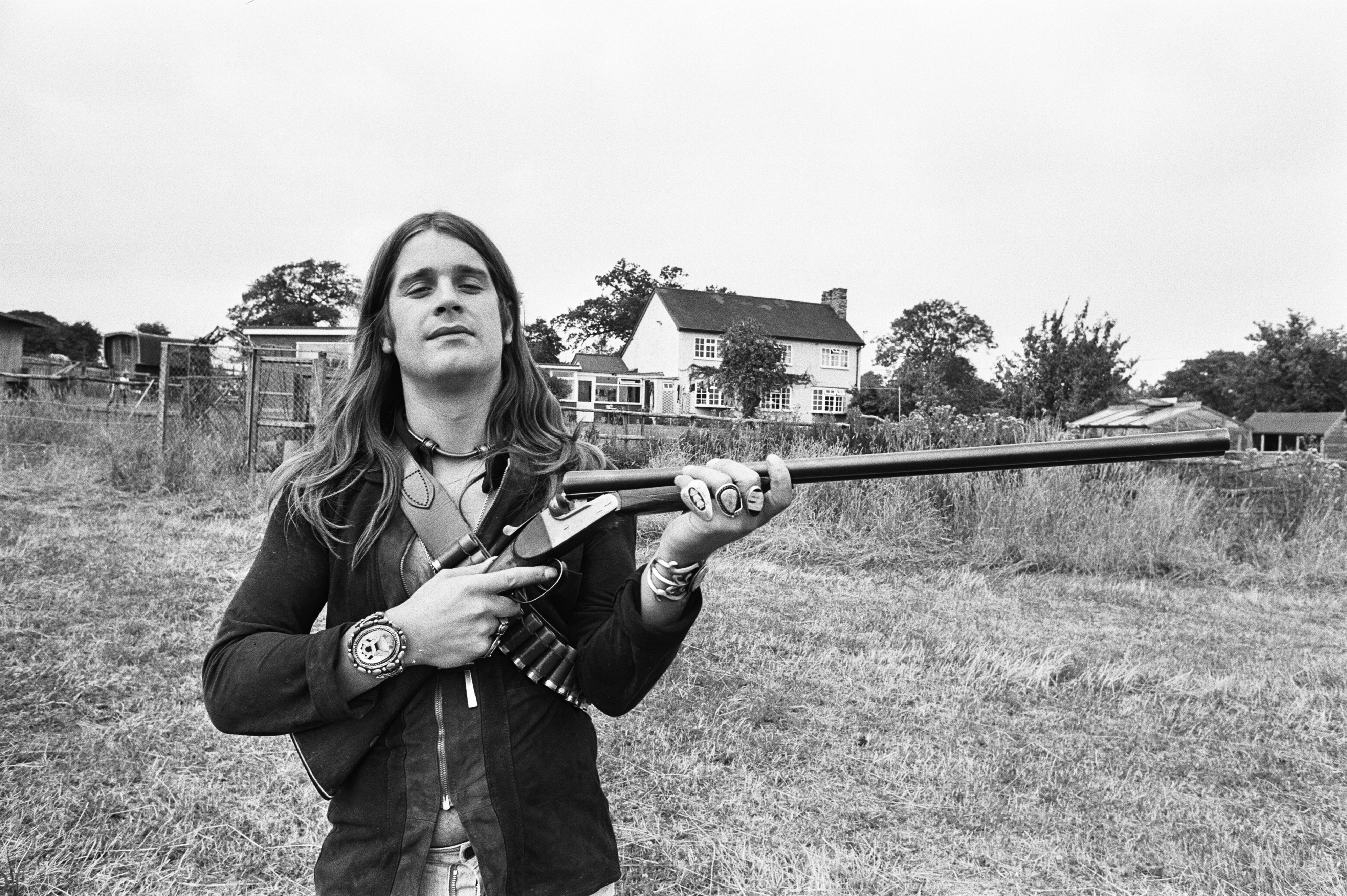 black_sabbath_ozzy_osbourne_with_a_shotgun_at_home_1976_poster_h_00530893.jpg