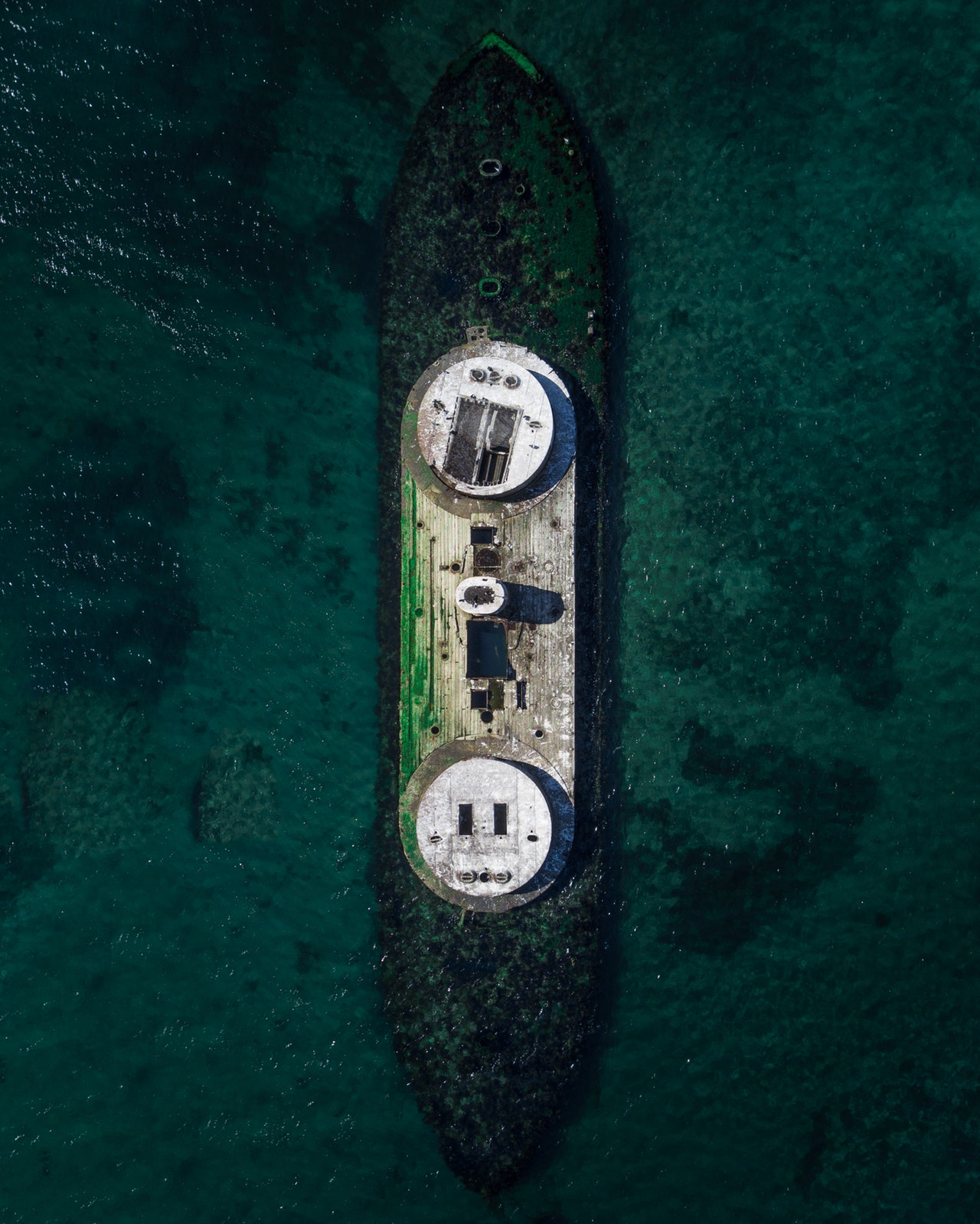aerial-photography-of-boat-in-water-1556909.jpg