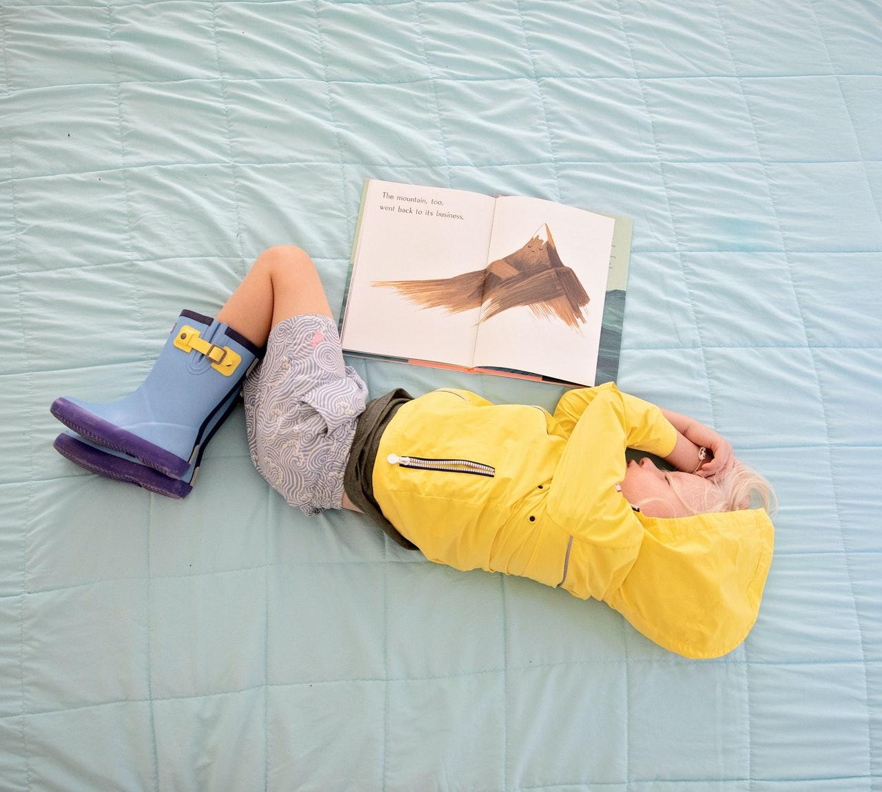 baby-in-yellow-hooded-jacket-sleeping-beside-book-2992878.jpg