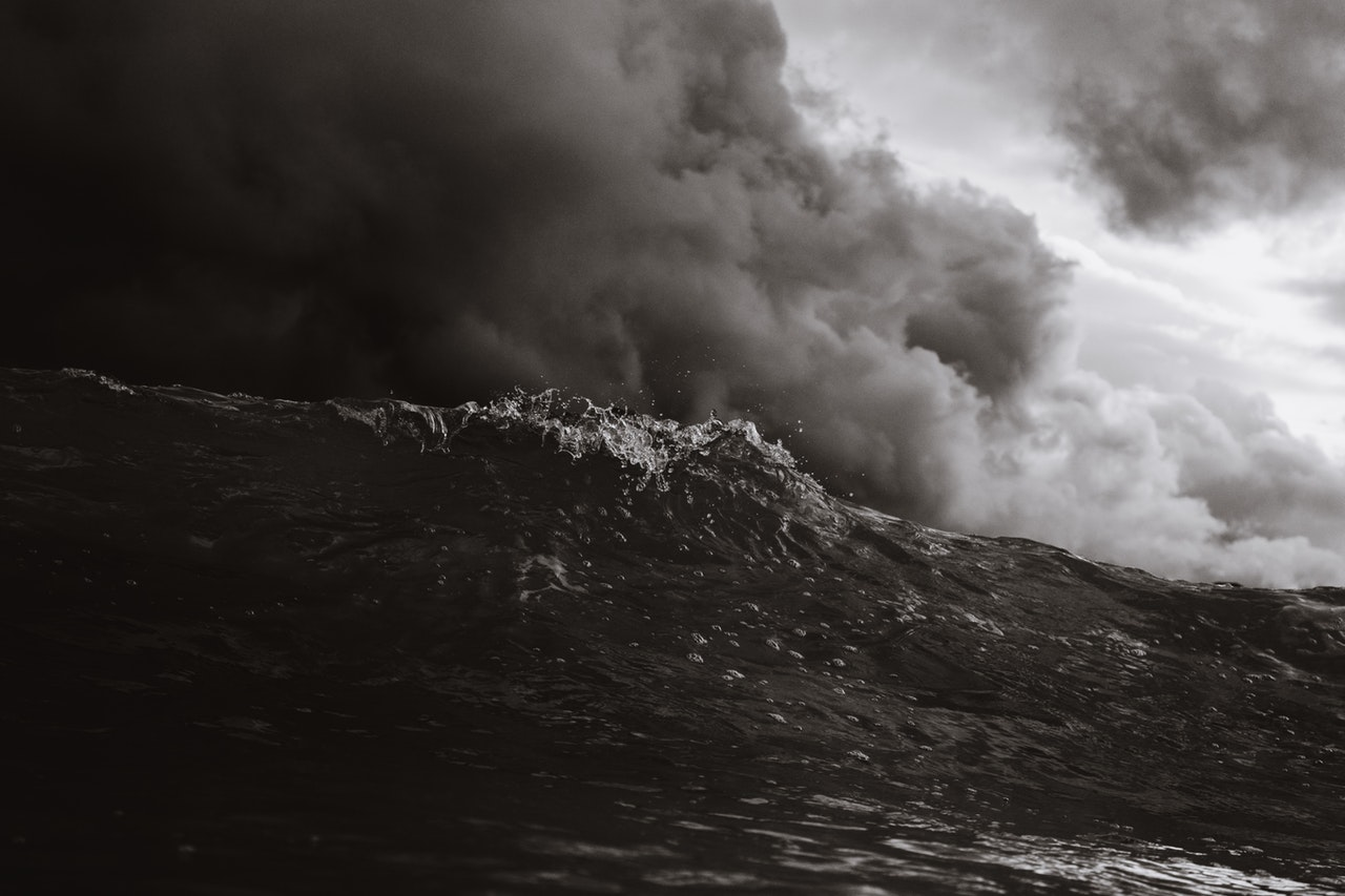 grayscale-photo-of-body-of-waves-1536304.jpg