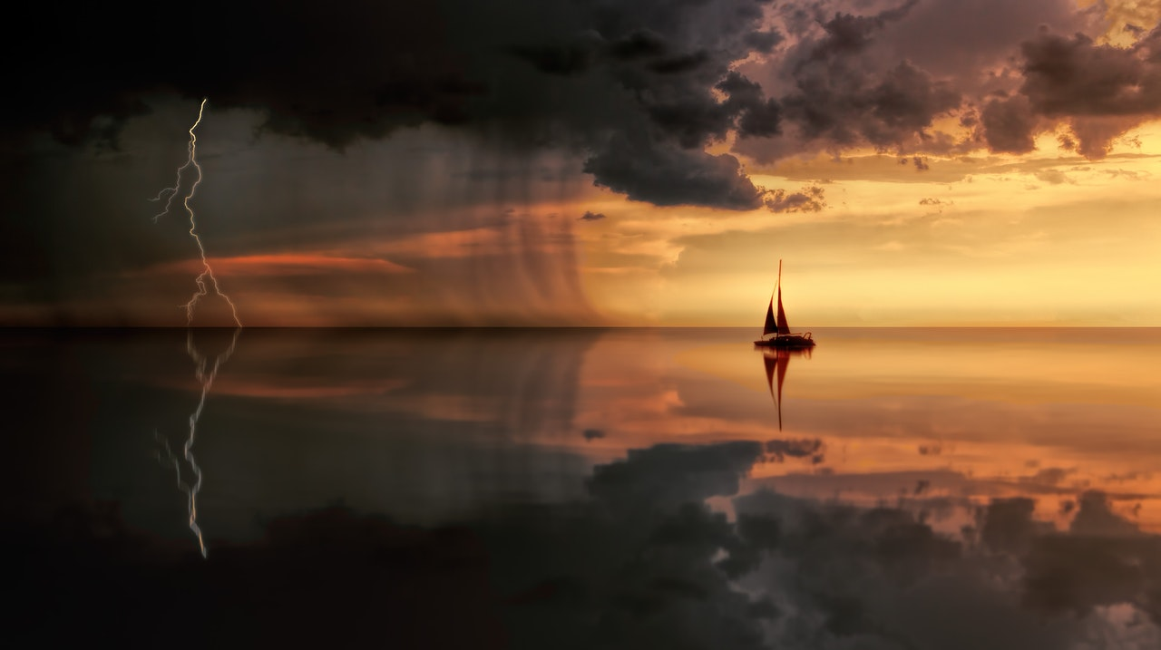 silhouette-photography-of-boat-on-water-during-sunset-1118874.jpg
