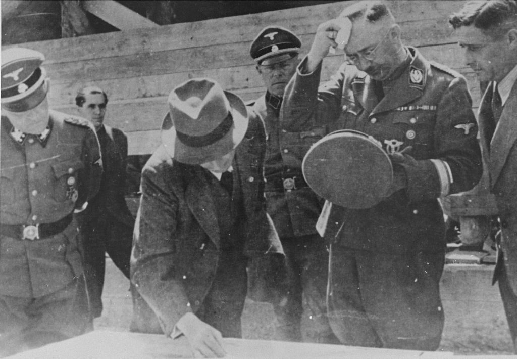 heinrich_himmler_and_max_faust_engineer_and_construction_manager_of_the_i_g_farben_auschwitz_plant_during_a_tour_of_the_building_site_near_the_concentration_camp_auschwitz_max_faust_shows_the_42jul17.jpg