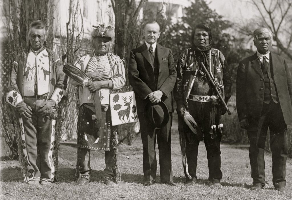president_calvin_coolidge_with_osage_indians_at_the_white_house_in_1925.jpg
