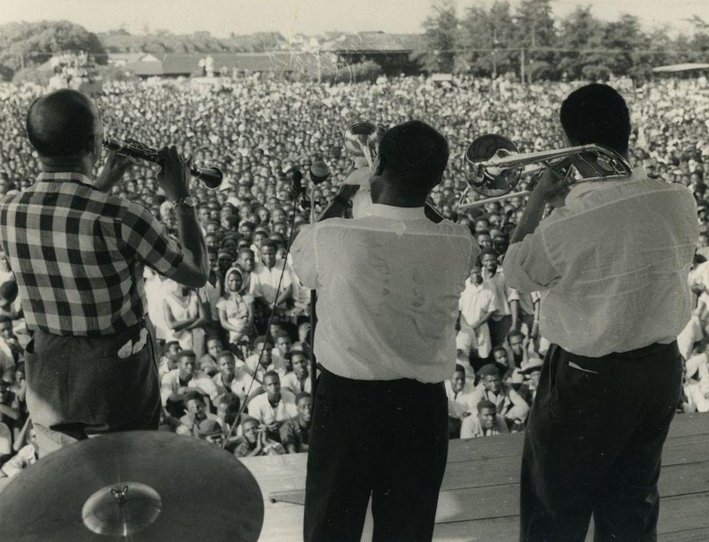 louis_armstrong_center_plays_in_accra_the_gold_coast_present_day_ghana_in_1956_to_a_crowd_estimated_at_100_000.jpg