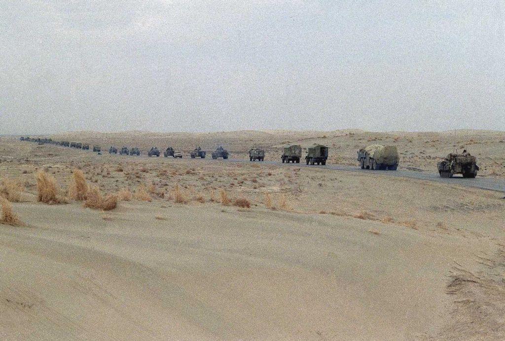 a_column_of_soviet_armor_and_military_trucks_moves_up_the_highway_toward_the_soviet_border_on_february_7_1989_in_hayratan.jpg