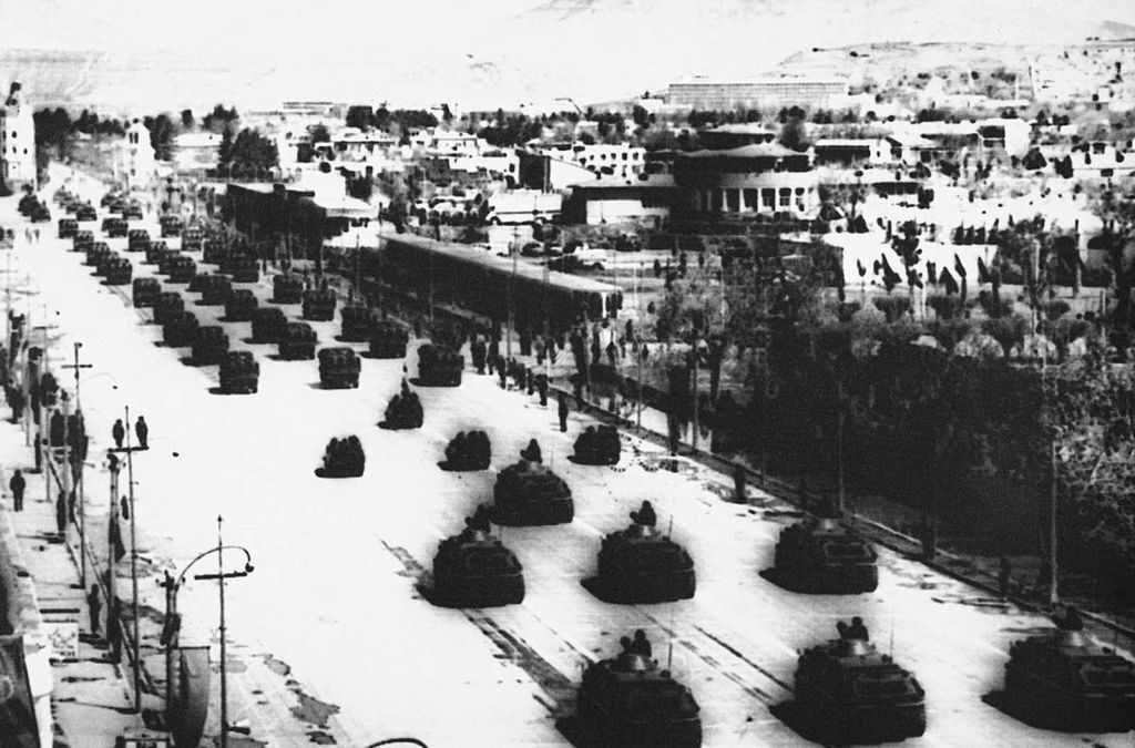 a_soviet-style_military_parade_held_on_the_occasion_of_5th_anniversary_of_afghanistan_s_1978_saur_revolution_in_the_streets_of_kabul_on_april_27_1983.jpg