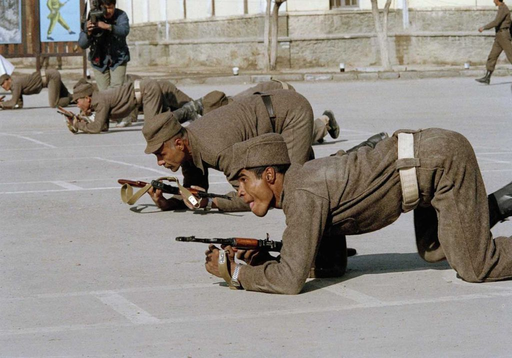 as_the_planned_withdrawal_of_soviet_troops_began_afghan_troops_were_trained_and_supplied_to_take_their_place_here_a_soldier_crawls_with_his_comrades_during_a_training_session_in_kabul_on_february_8_1989.jpg