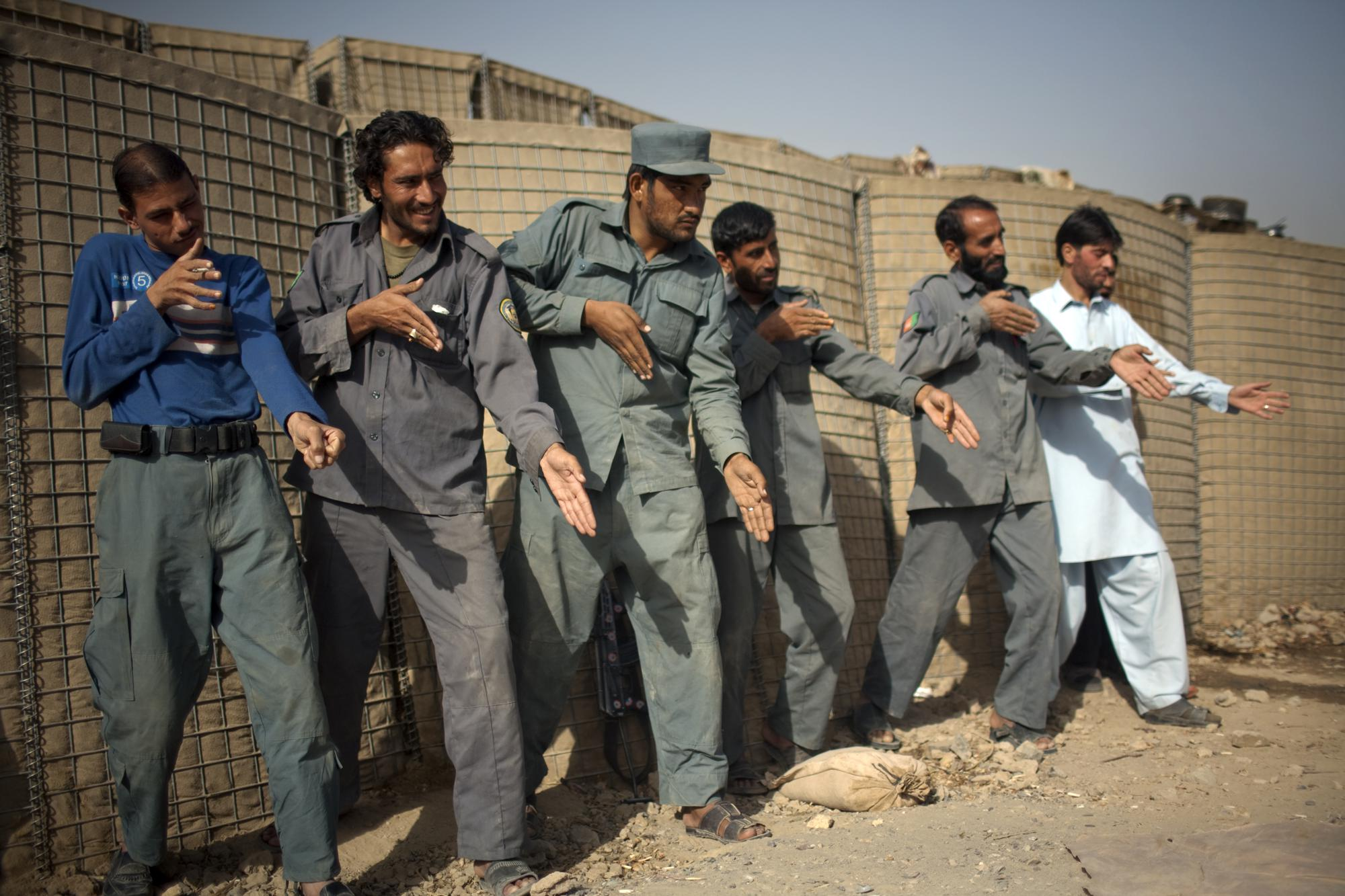 fghan_policemen_simulate_weapons_orientation_during_a_training_session_with_u_s_soldiers_2010.jpeg