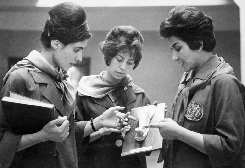 picture_taken_in_1962_at_the_faculty_of_medicine_in_kabul_of_two_afghan_medicine_students_listening_to_their_professor_at_right_as_they_examine_a_plaster_cast_showing_a_part_of_a_human_body.jpg