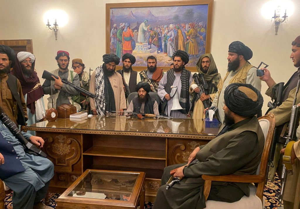 taliban_fighters_sit_inside_the_presidential_palace_in_kabul_in_august_2021.jpg