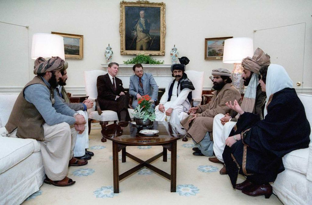 u_s_president_ronald_reagan_meets_with_a_group_of_afghan_freedom_fighters_to_discuss_soviet_atrocities_in_afghanistan_especially_the_september_1982_massacre_of_105_afghan_villagers_in_lowgar_province.jpg