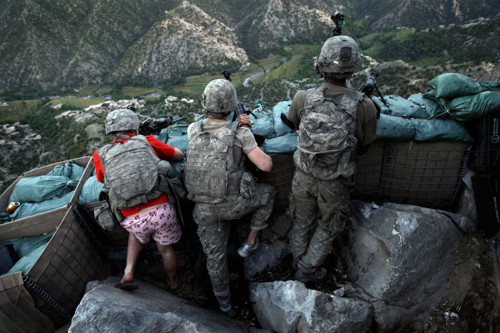 us_soldiers_take_defensive_positions_after_receiving_fire_from_taliban_positions_in_korengal_valley_in_may_2009_zachary_boyd_was_still_in_his_i_love_ny_boxers_because_he_rushed_from_his_sleeping_quarters.jpg