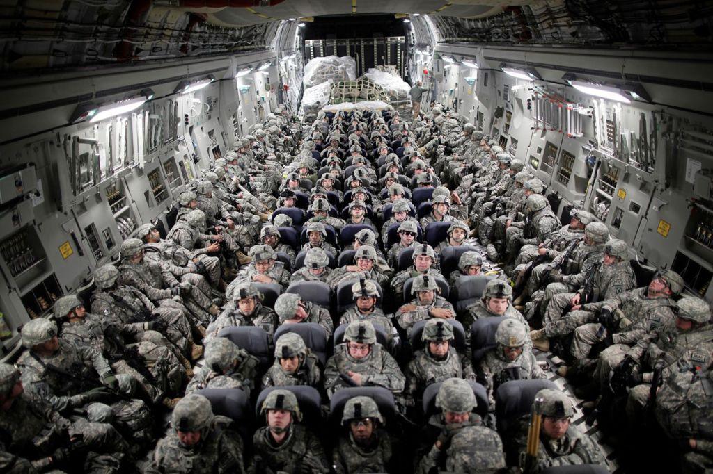 us_troops_aboard_a_c-17_transport_plane_head_to_afghanistan_in_april_2010.jpg