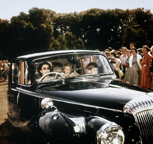 1957_queen_elizabeth_driving_her_children_prince_charles_and_princess_anne_in_windsor.jpg