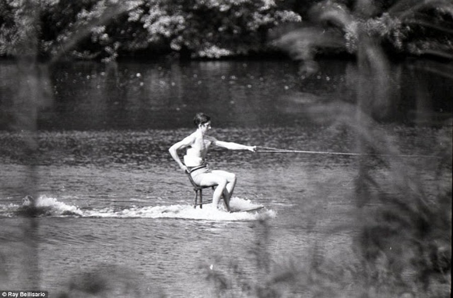 1970_prince_charles_in_june_1970_whizzing_across_the_lake_at_sunninghill_park_on_a_chair_balanced_on_a_table.jpg