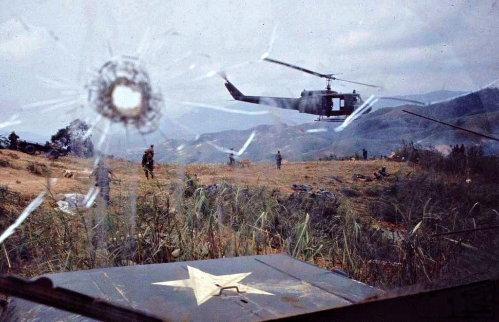 1968_a_huey_seen_through_the_shot_windscreen_of_an_american_jeep_vietnam2.jpg