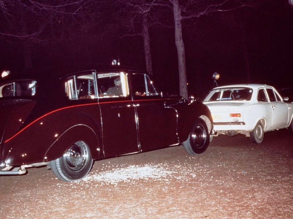 1974_the_aftermath_of_ian_ball_s_attempt_to_kidnap_princess_anne_ball_s_white_ford_escort_is_parked_blocking_the_path_of_the_princess_s_rolls_royce_limousine.jpg