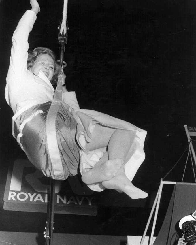 1983_prime_minister_margaret_thatcher_swinging_from_a_hoist_during_a_visit_to_the_royal_navy.jpg