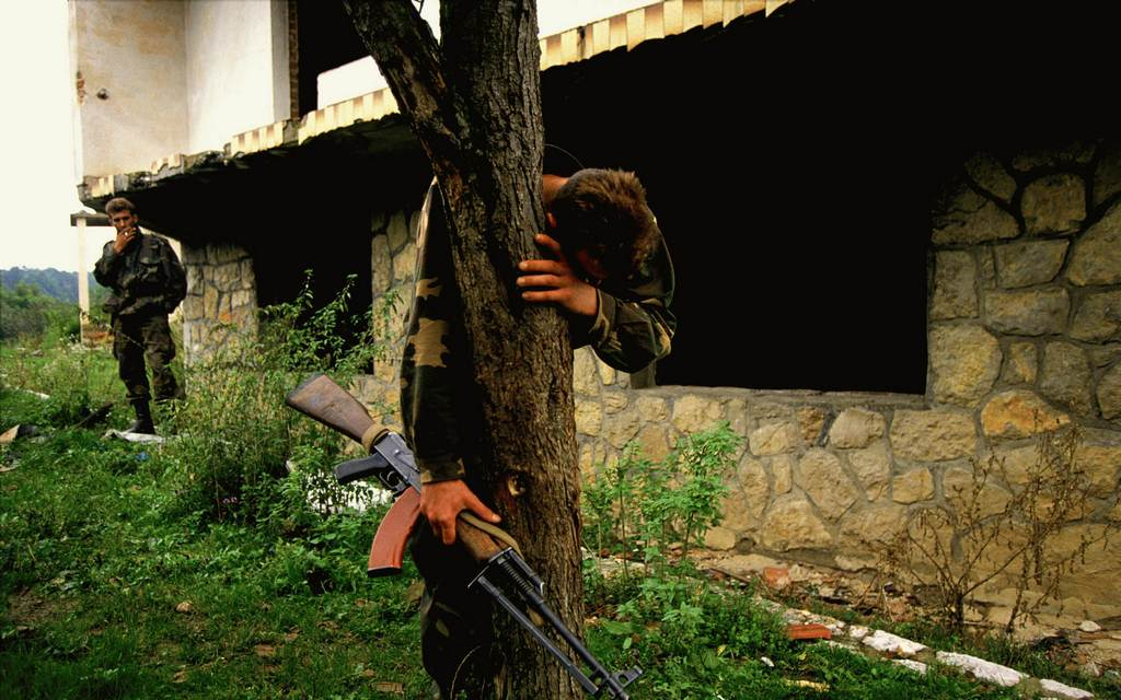 1995_a_bosnian_soldier_stands_on_what_is_believed_to_be_a_mass_grave_outside_his_destroyed_home_he_was_the_sole_survivor_of_69_people.jpg