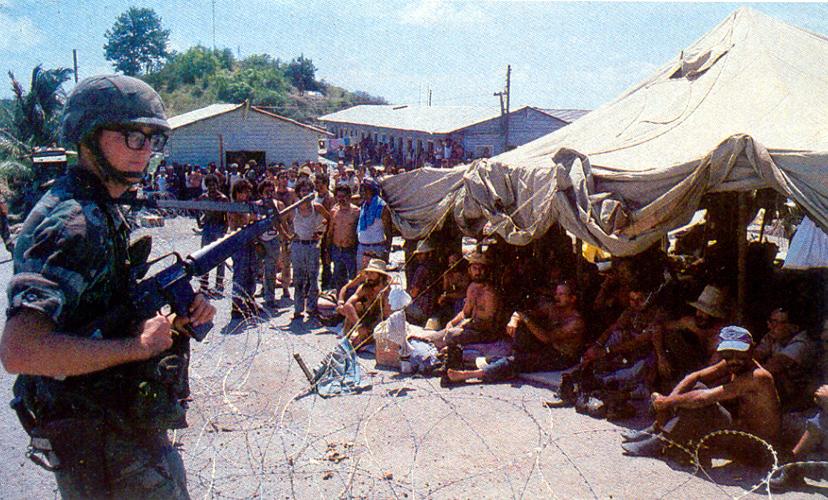1983_amerikai_katona_orzi_a_magukat_megado_kubai_csapatokat_a_grenadai_konfliktus_idejen_a_baloldali_befolyas_ellen_az_usa_a_karibi_sziget_megszallasaval_valaszolt.jpg