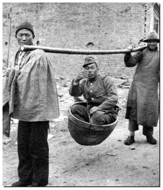 1938_japanese_army_officer_makes_two_chinese_men_carry_him.jpg