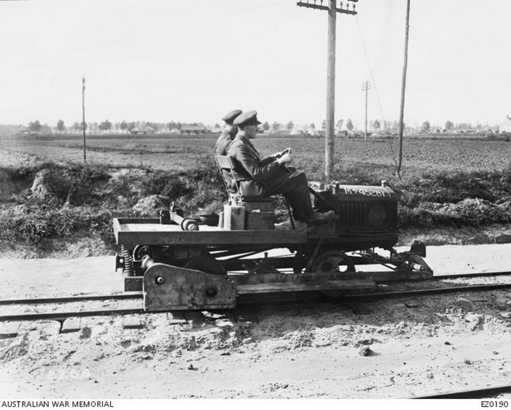 1917_two_officers_travelling_on_a_t_model_ford_chassis_that_has_been_adapted_for_use_on_a_light_railway.jpg