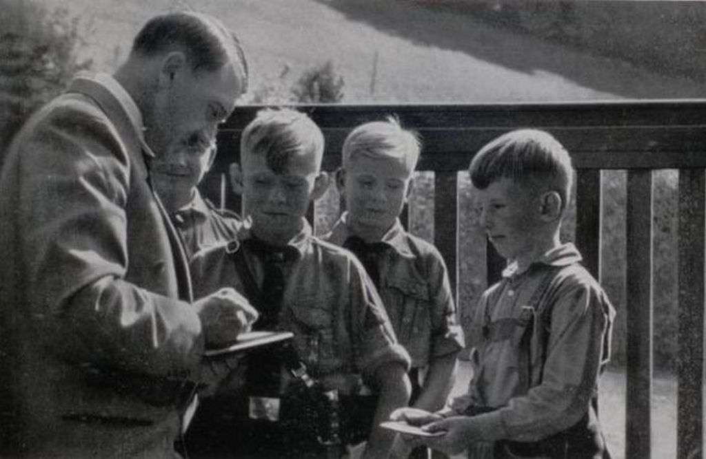 1935_adolf_hitler_signing_autographs_for_some_hitler_youth_children.jpg