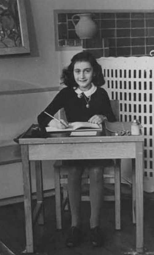 1941_anne_frank_getting_her_school.jpg