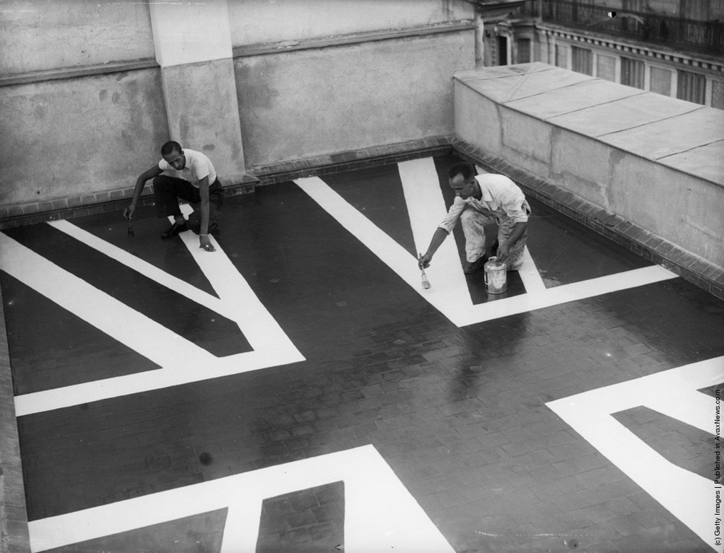 1936_workmen_paint_a_union_jack_flag_on_the_roof_of_the_british_embassy_in_madrid_during_the_height_of_the_siege_by_rebel_troops.jpeg