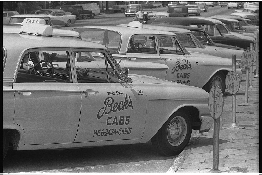 1962_taxi_cabs_with_sign_white_only_on_side_albany_georgia.jpg