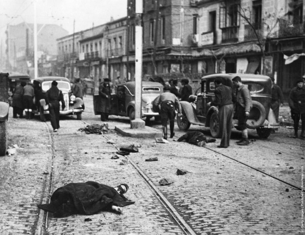 1937_victims_of_a_sudden_air_raid_lie_in_a_street_during_the_spanish_civil_war.jpeg